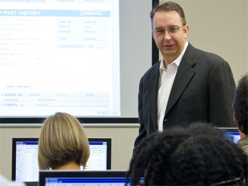 Dr. Robert Hitchcock conducts a training session with ED staff.